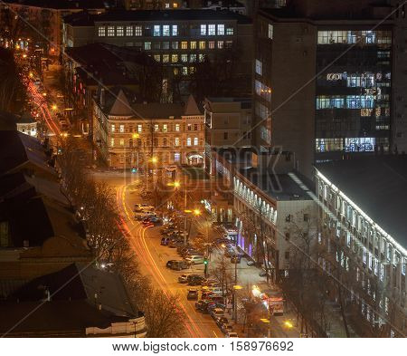 View from roof at night city street, houses, cars. Voronezh. Modern city concept. Copy space. Top view from roof