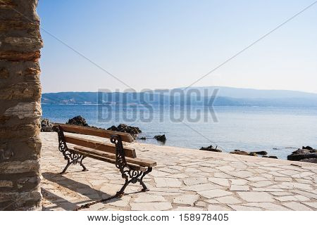 Bench and beautiful seeview in sunny calm greek day. Ammouliani Island in Chalkidiki, Northern Greece