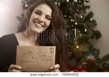 Girl smiling with a letter so Santa