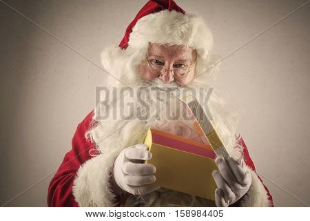 Santa opening a present