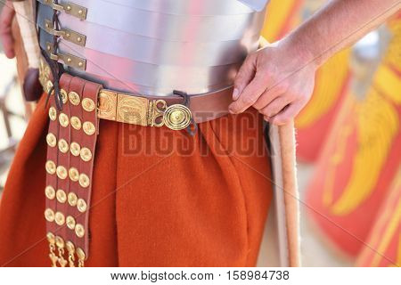 MOSCOW - JUN 06, 2015: Leather belt with protective plaques at the waist Roman soldier at the festival Times and epoch: Ancient Rome in Kolomenskoye