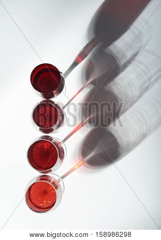 red wine glasses view from top with  shadows isolated on white background