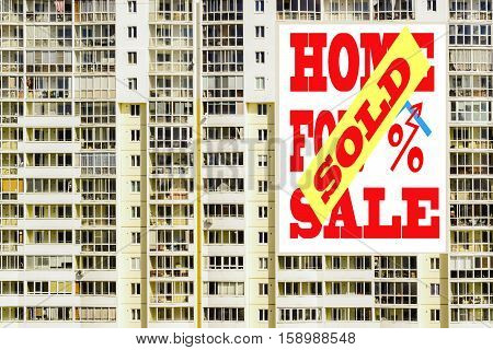 A Billboard advertising the sale of real estate  . The concept of changes in housing prices