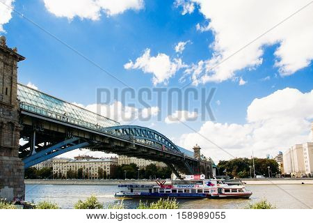 Moscow Russia - August 17 2016: Pushkinsky(Andreevskiy) bridge across the Moscow-River with a passing underneath boat