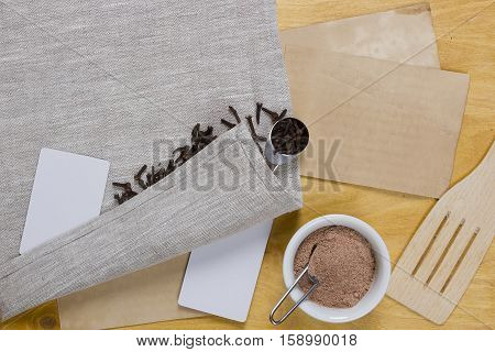 Clove whole and milled on linen napkin