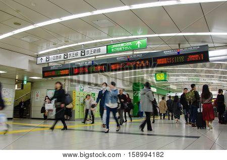 Tokyo Japan - November 21 2016 : Passengers at Shinjuku station in Tokyo Japan .