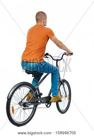 back view of a man with a bicycle. cyclist rides a bicycle. Rear view people collection.  backside view of person. Isolated over white background. Man riding a bicycle