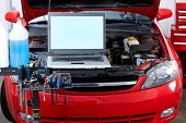 stock photo of internal combustion  - Car with open hood in auto repair shop - JPG
