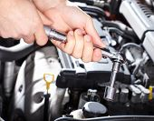 foto of auto garage  - Hand with wrench - JPG