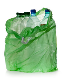 picture of plastic bottle  - simple plastic bottles in a garbage bag on a white background - JPG