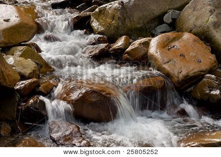 Water Flow (stream) Among The Stones