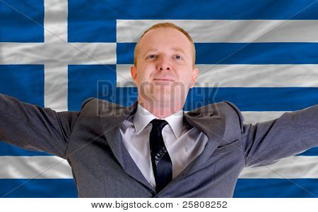Happy Businessman Because Of Profitable Investment In Greece Standing Near Flag