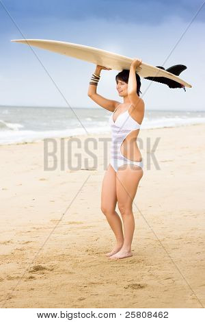 Girl Standing With Surfboard