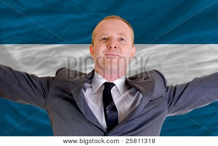 Happy Businessman Because Of Profitable Investment In El Salvador Standing Near Flag