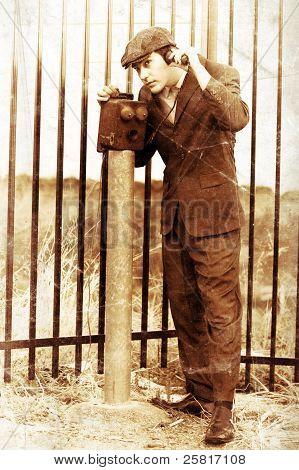 Olden Day Gentleman Communicating On Box Telephone