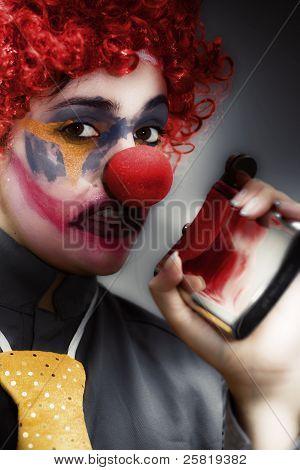 Clown Holding Flask