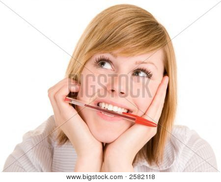 Girl Biting On Pen While In Deep Thought And Looking Up
