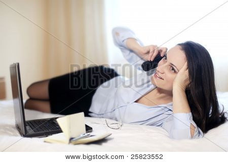 Businesswoman In A Hotel Room