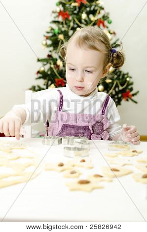 Little Cute Girl Making Christmas Cookies