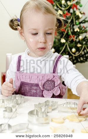 Little Cute Girl Making Christmas Cookies