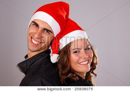 Happy Christmas Young Couple, Studio Shot.