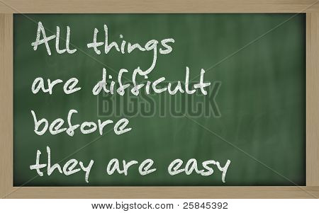 """ All Things Are Difficult Before They Are Easy "" Written On A Blackboard"