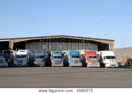 Seven Trucks At Warehouse