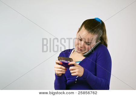 Teen Girl Using Two Phones