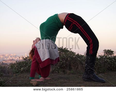 Beautiful Redheaded Lady Does A Backbend
