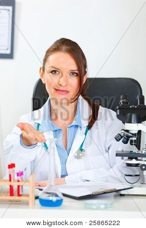 Doubting Doctor Woman Showing On Something