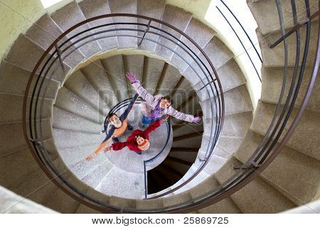 beautiful young girl with mother on staircase