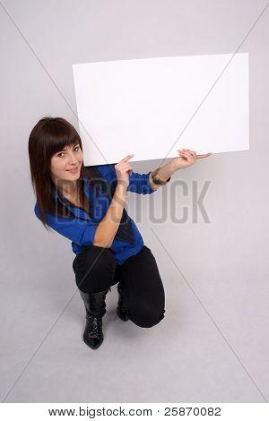 Pretty girl holding blank banner.
