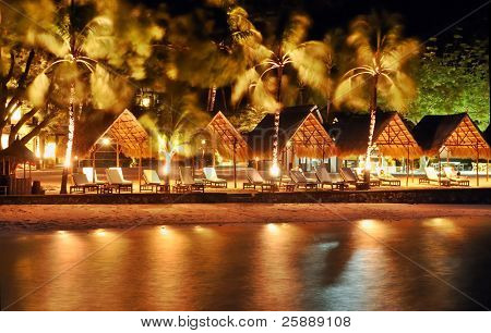 Night Beach with huts and Sunbeds