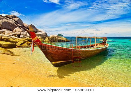 Thai Longtail Boat Anchored in a Turqouise Bay