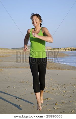 happy woman running on beach