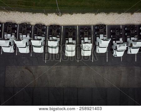 Fleet Of White 18wheeler Semitrucks