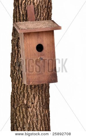 Handmade bird house (starling house) on a tree trunk against white background