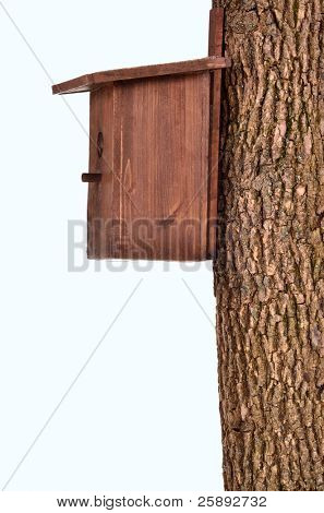 Wooden starling-house on a bole isolated on white background