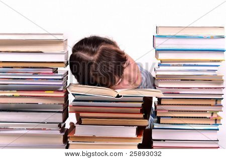 Little gire reading a book sleeping among stacks of books isolated on white background