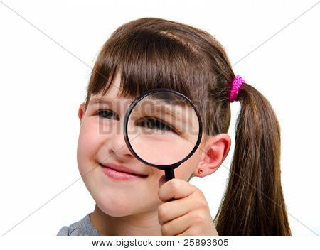 Beautiful little girl looking through a magnifying glass, isolated on white background