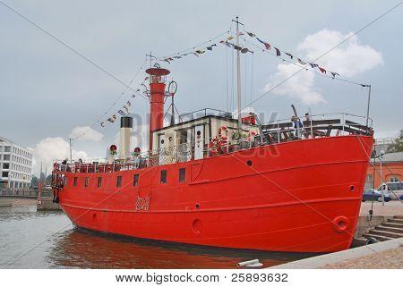 Red transport boat in the harbor in Helsinki, Finland