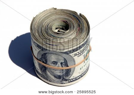 ten thousand dollars rolled up and held together with a rubber band isolated on a white background with shadow