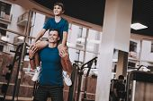 Happy Father And Son Have Fun In Modern Sport Club. Healthy Lifestyle Concept. Sport And Training Co poster