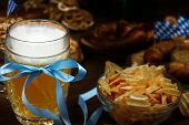 October Fest Concept. Wooden Table In Pub Pint Glass Cup Of Beer With Blue Tape, Snacks, Chips, Swee poster