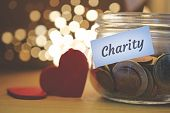 Charity Money Jar With Blurred Lights, Closeup poster