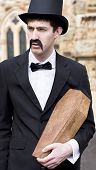 pic of pallbearer  - Portrait Of A Well Dressed Funeral Director Man Holding A Small Coffin - JPG