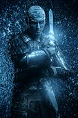 Halloween. Frozen snow covered zombie warrior in the armor of a medieval knight. poster