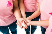 Partial View Of Women In Pink T-shirts Holding Breast Cancer Awareness Ribbon Isolated On White poster