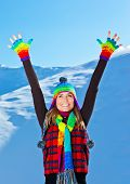 Happy Cute Girl Playing In Snow Outdoor, Christmas Winter Holidays Travel And Vacation