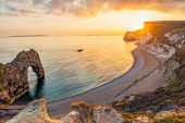 Landscape Of Empty Durdle Door Beach At Sunset. Dorset England poster